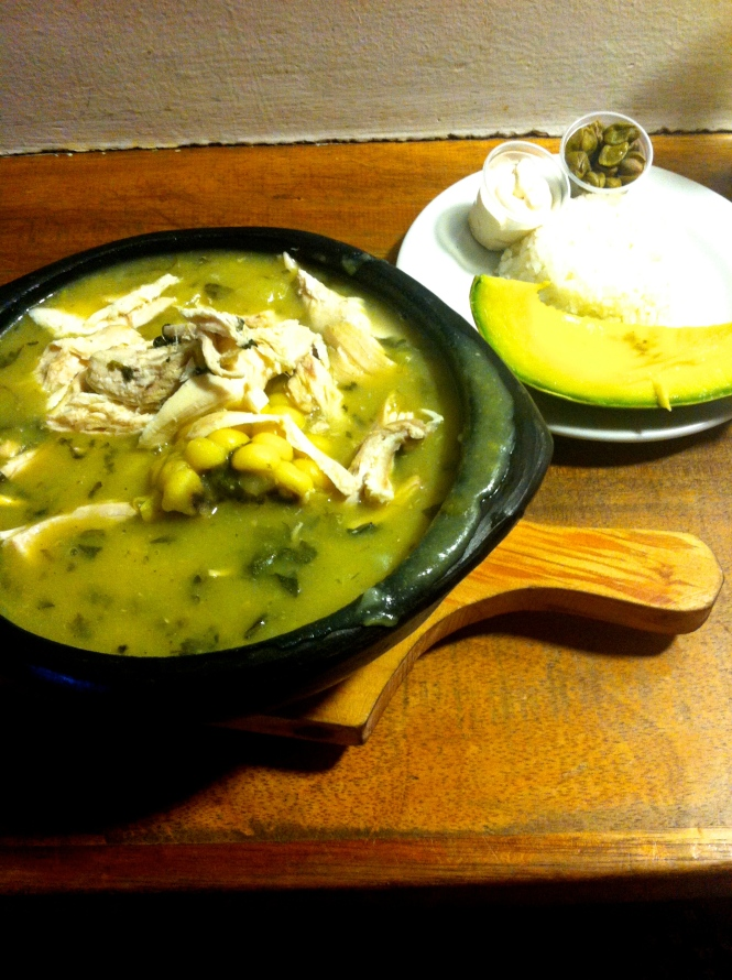 Ajiaco, a potato-based, delicious chicken soup, served with white rice, lentils, cream, and avocado. I got this one at La Puerta Falsa in Bogotá.