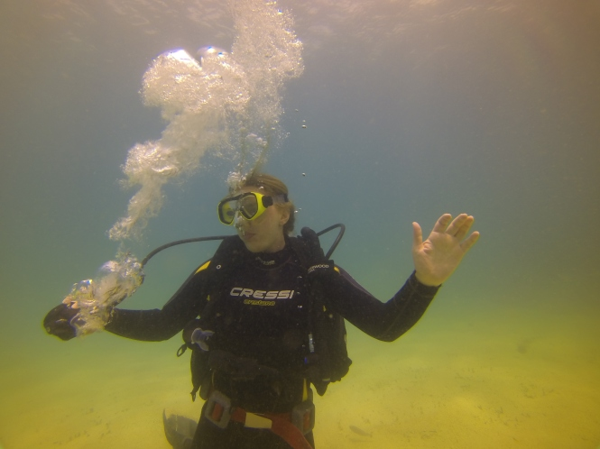 Practicing taking out my regulator under water... looks like I'm dancing though.