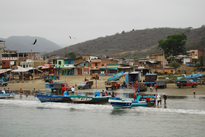 Fishermen bringing in the day's catch in Puerto Lopez, Ecuador.
